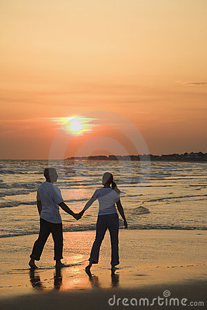 Free Couple On Beach At Sunsest. Stock Photography - 2046252