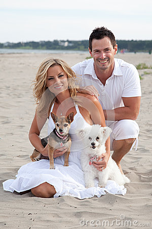 Free Couple On Beach With Pet Dogs Royalty Free Stock Images - 35338619