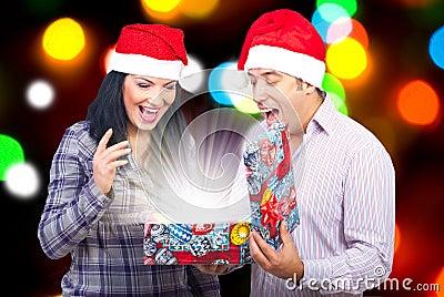 Couple open a magic Christmas gift