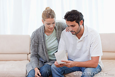 Couple opening an envelope
