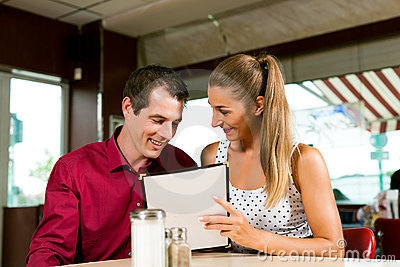Couple order in a bar or restaurant