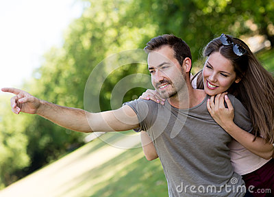 Couple outdoors looking at something