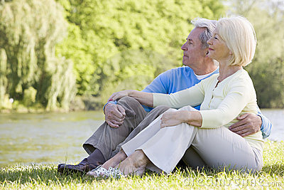 Couple outdoors at park by lake