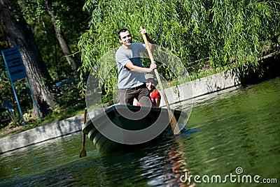 Couple paddling in rowboat