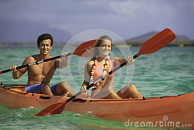 Couple paddling their kayak