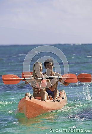 Couple paddling their kayak