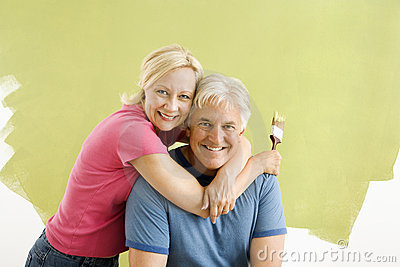 Couple with paintbrushes.