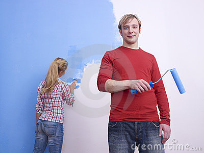 Couple painting room blue