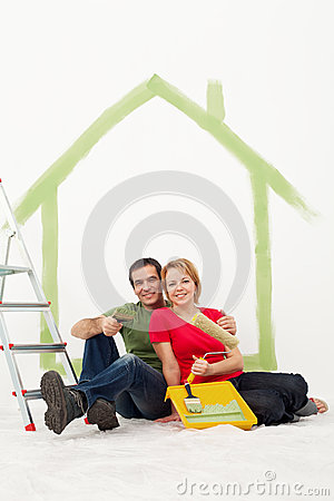 Couple with painting utensils resting
