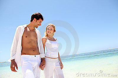 Couple on paradisiacal beach