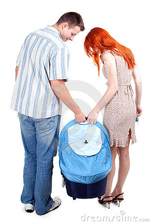 Couple with part of baby buggy