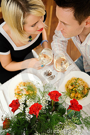 Couple with pasta and wine