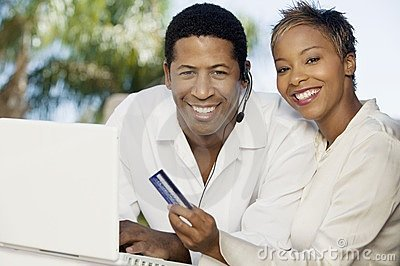 Couple on patio making online credit card purchase