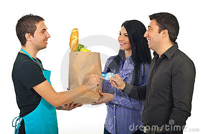 Couple paying with credit card at grocery