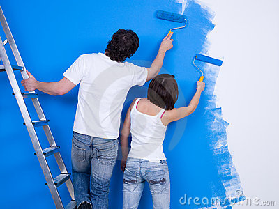 Couple of people painting the wall