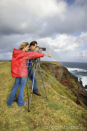 Couple photographing scenery in Maui, Hawaii.