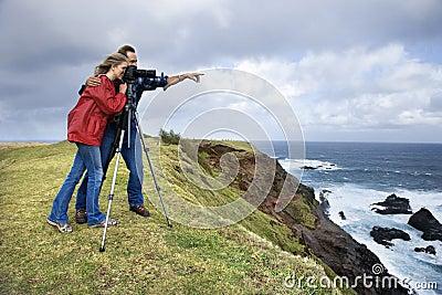 Couple photographing scenery in Maui, Hawaii.