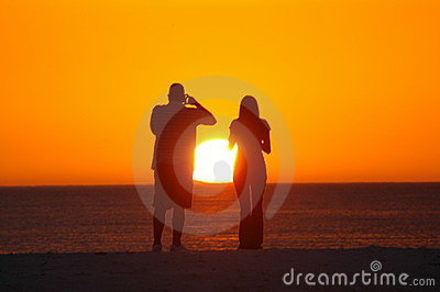 Couple photographing sunset