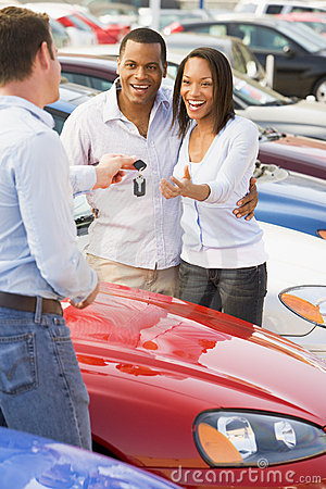 Free Couple Picking Up New Car From Salesman Stock Photos - 5096203