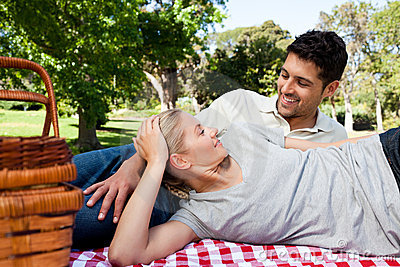 Couple picnicking in the park