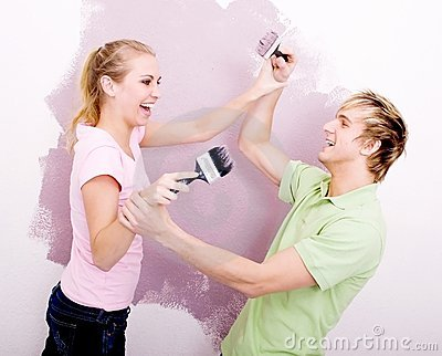 Couple play-fighting with paint