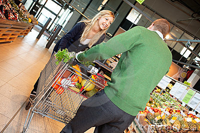 Couple in playful mood in store