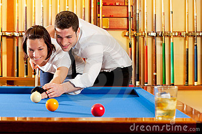Couple playing billiard expertise teacher
