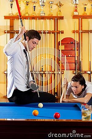 Couple playing billiard expertise teacher