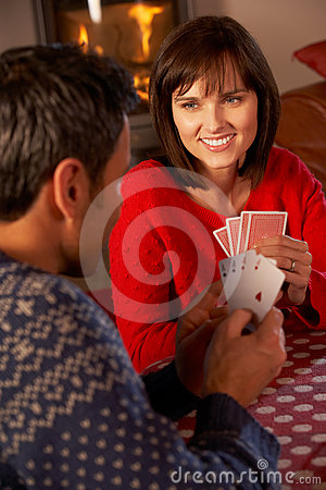 Couple Playing Cards By Cosy Log Fire