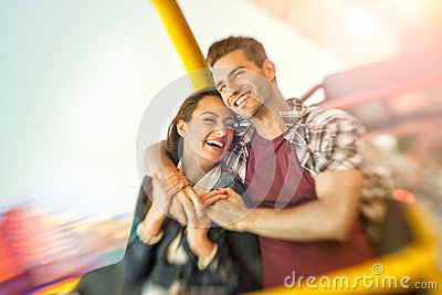 Couple playing shooting games while visiting an amusement park