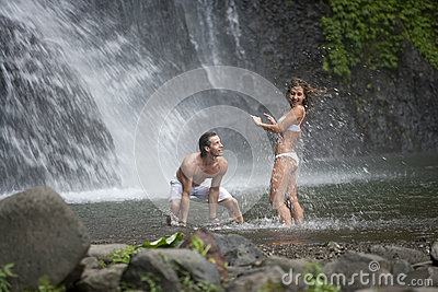 Couple Playing Under Waterfalls