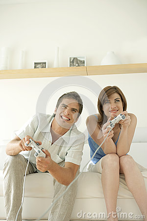 Couple Playing Video Games on Sofa