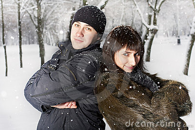 Couple playing in winter park