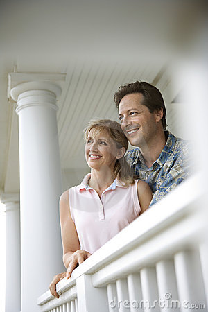 Couple on Porch of Home