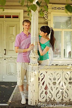 couple pose on terrace village house