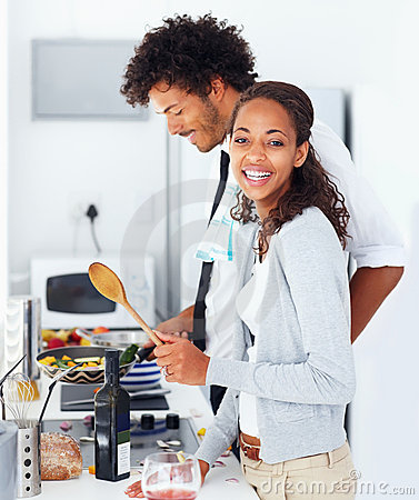Couple preparing food together at home