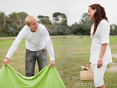Couple preparing romantic picnic