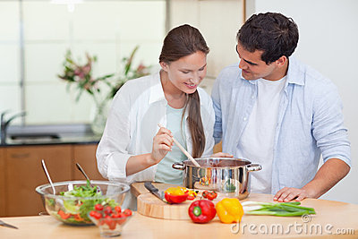 Couple preparing a sauce