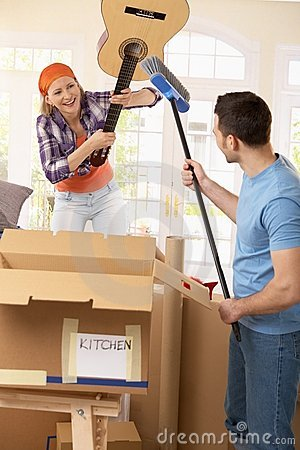Couple pretending to fight at moving house