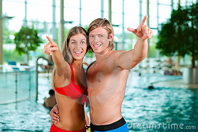 Couple in public swimming pool