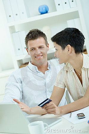 Couple purchasing with credit card