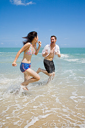 Couple racing on the beach wit