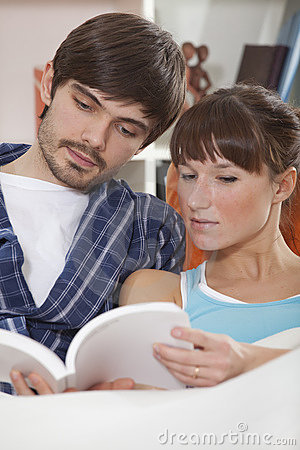 Couple Reading Book In Bed Stock Photo - Image: 17587610