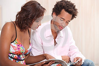 Couple reading a brochure