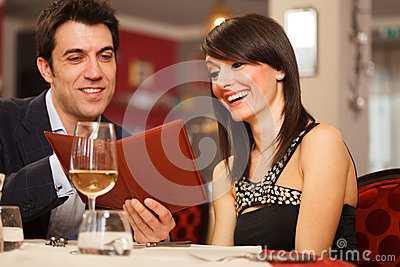 Couple reading the menu