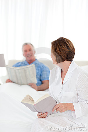 Couple reading together in the bed