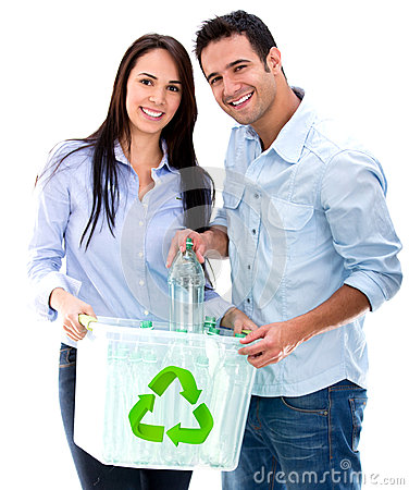 Couple recycling bottles