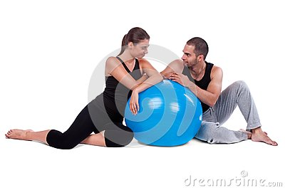Couple relaxing on fitball