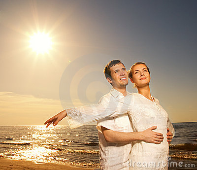 Couple relaxing near the sea