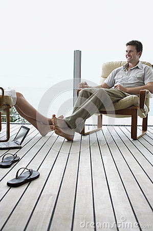 Free Couple Relaxing On Porch Stock Image - 31829561